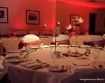 red mood lighting behind top table